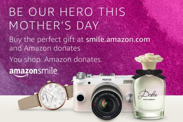 Text: Be our hero this Mother's Day: Buy the perfect gift at smile.amazon.com and Amazon donates. You shop. Amazon donates. Amazon Smile. Image: Watch, camera and perfume